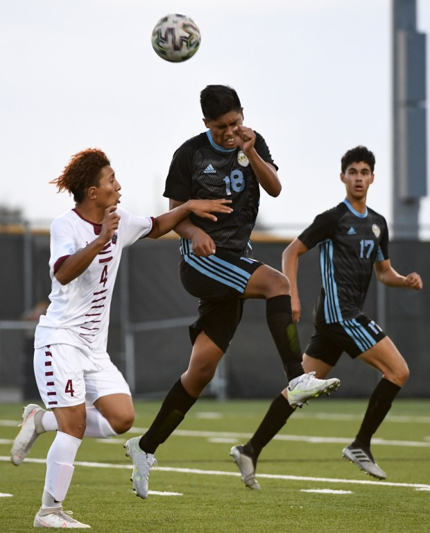 GREELEY, CO - AUGUST 26:Greeley West's Ever Ramirez (18) leaps for a header over Northridge's Roberto Manza (4) during the Greeley West Spartans boys soccer match against the Northridge Grizzlies at District 6 Soccer Stadium in Greeley Aug. 26, 2021. The Grizzlies and Spartans played to a 1-1 draw through two overtime periods. (Alex McIntyre/Staff Photographer)