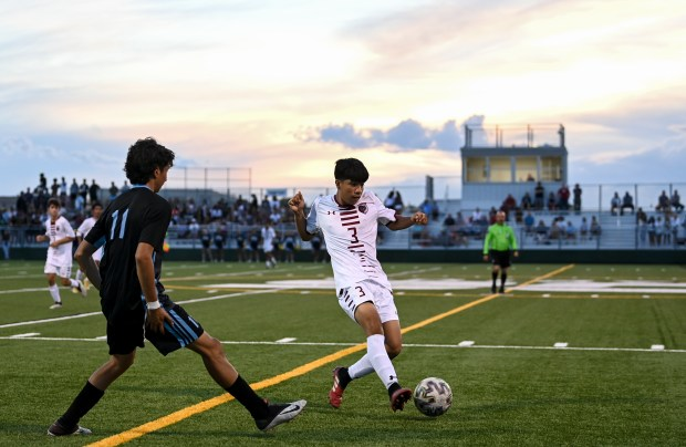 GREELEY, CO - AUGUST 26:Northridge's Jason Vicente (3) passes ahead of Greeley West's Martin Uribe (11) during the Greeley West Spartans boys soccer match against the Northridge Grizzlies at District 6 Soccer Stadium in Greeley Aug. 26, 2021. The Grizzlies and Spartans played to a 1-1 draw through two overtime periods. (Alex McIntyre/Staff Photographer)