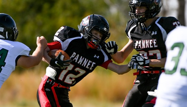 GROVER, CO - SEPTEMBER 17:Pawnee's Hunter Newlon (12) runs during the Pawnee Coyotes 1A 6-man football game against the Fleming Wildcats at Pawnee High School in Grover Sept. 17, 2021. The Pawnee Coyotes fell to the Fleming Wildcats 70-0. (Alex McIntyre/Staff Photographer)