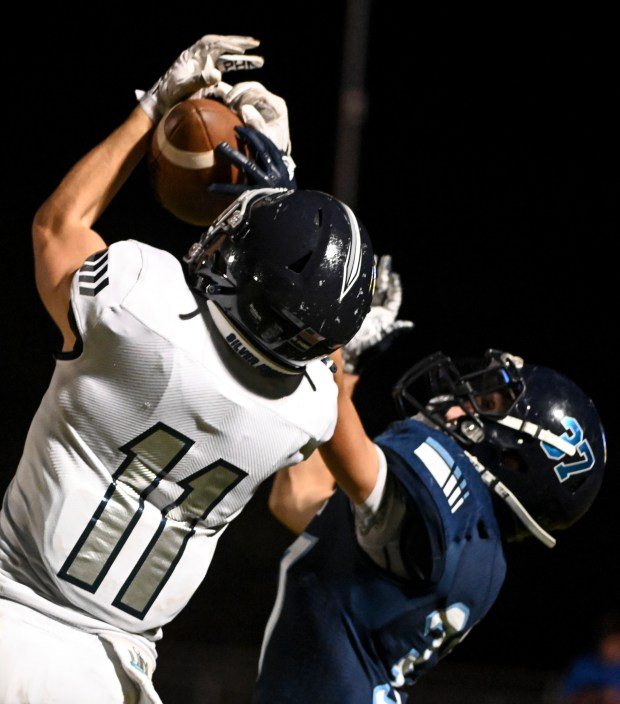 KERSEY, CO - SEPTEMBER 09:Severance's Trevin Hull (11) makes a catch under pressure from Platte Valley's Hunter Pagel (37) during the Severance Silver Knights football game against the Platte Valley Broncos at Platte Valley High School in Kersey Sept. 9, 2021. The Silver Knights defeated the Broncos 17-14. (Alex McIntyre/Staff Photographer)