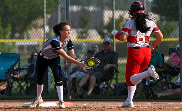 GREELEY, CO - SEPTEMBER 07:University's Brooklyn Smith (36) makes the catch to tag out Eaton's Olivia Comer (8) during the University Bulldogs softball game against the Eaton Reds at Twin Rivers Ballparks in Greeley Sept. 7, 2021. The Reds defeated the Bulldogs 6-4. (Alex McIntyre/Staff Photographer)