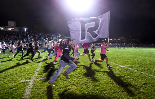 JOHNSTOWN, CO - OCTOBER 08:Roosevelt fans storm the field after the Roosevelt Roughriders won their football game against the Mead Mavericks at Roosevelt High School in Johnstown Oct. 8, 2021. The Roughriders defeated the Mavericks 37-7. (Alex McIntyre/Staff Photographer)
