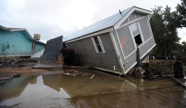 In this 2013 Tribune file photo, a mobile home is tipped on its side at the Eastwood Village Mobile Home Park in Evans. Most of the mobile homes were destroyed in the September 2013 flooding. (Jim Rydbom/For The Tribune)