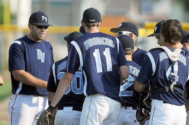 Platte Valley head coach Jerod Cronquist, left, talks with his team during a game against Valley last season.