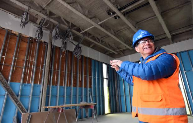 Bob Ghent, an investor for the hotel project, smiles as he talks about one of the murals that will be featured at the DoubleTree Hilton Greeley-Lincoln Park Hotel in downtown Greeley. The hotel will feature 147 rooms once finished.