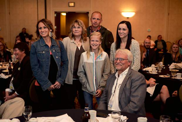 Former Greeley Tribune Editor Randy Bangert is surrounded by family after winning Newspaper Person of the Year at the Colorado Press Association Convention in 2016.
