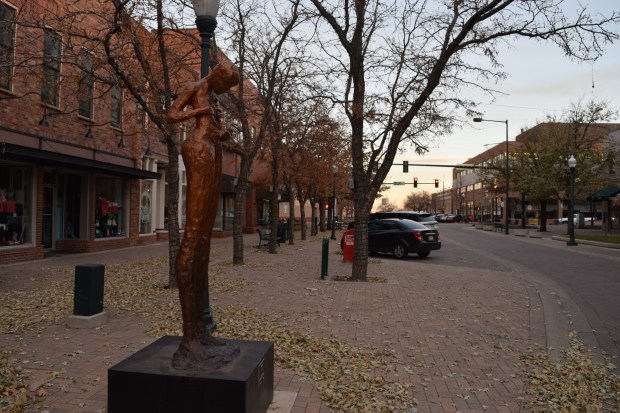 """Peace,"" by Lorria Acott, is one of four sculptures on loan remaining in downtown Greeley, at 8th Street between 8th and 9th avenues. (Trevor Reid/treid@greeleytribune.com)"