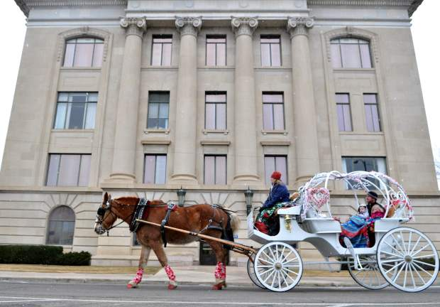 Take your sweeties on a horse-drawn carriage around downtown Denver on Valentine's Day. (Greeley Tribune file photo)
