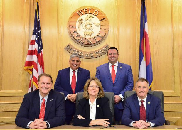 The Weld County Board of County Commissioners poses for a photo; front left, Scott James, front center, Barbara Kirkmeyer, front right Mike Freeman, back left Steve Moreno, back right Kevin Ross
