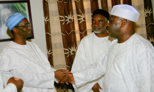 Former Vice President Atiku Abubakar a handshake with Mallam Nuhu Ribadu while Governor Murtala Nyako of Adamawa (centre) looks on during a meeting in Abuja on Friday