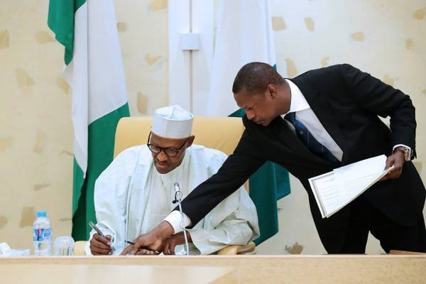 President Muhammadu Buhari signing the document today, 24, 08 2017