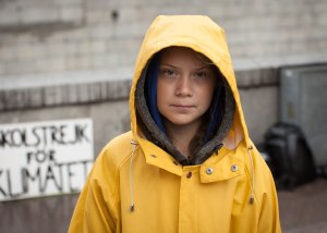 Greta Thunberg with protest sign