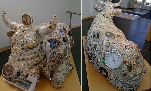 Cow sculpture from recycled watches and clocks