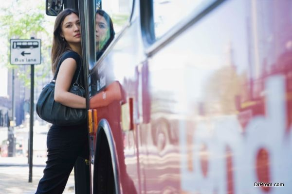 Woman getting on bus in London, England