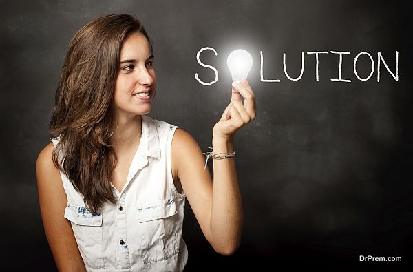 young woman holding a lightbulb composing solution word