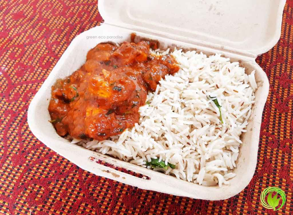 Paneer butter masala and jeera rice in biodegradable food packaging box