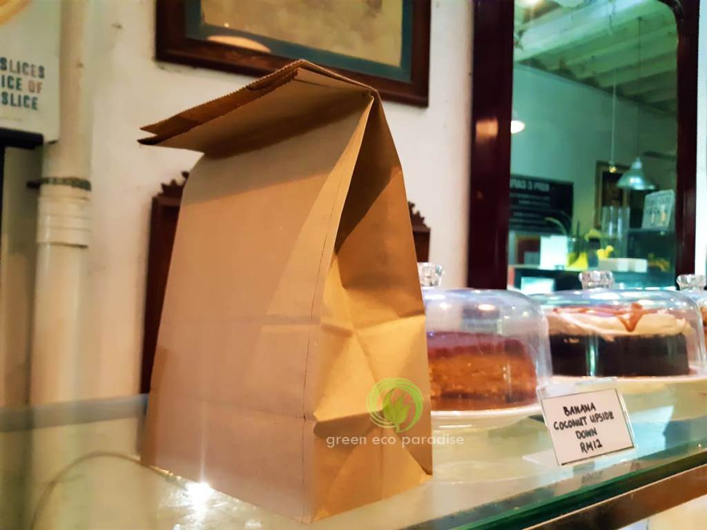 A few cake boxes slid inside the paper bag. A genuine supplier in Malaysia.