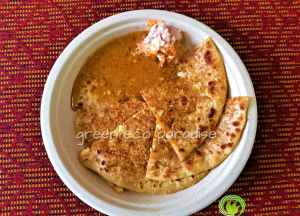 Stuffed parotha and gravy served on bio plate