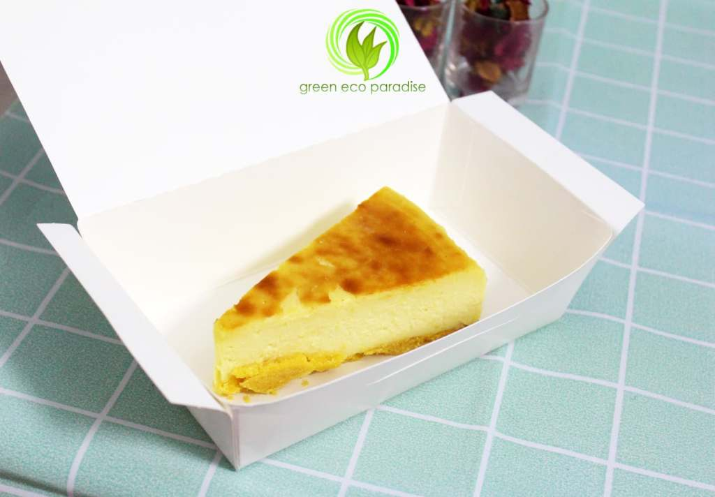 A slice of cheesecake in the disposable food box.