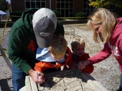 Families enjoy making the Bloomfield Art Mural