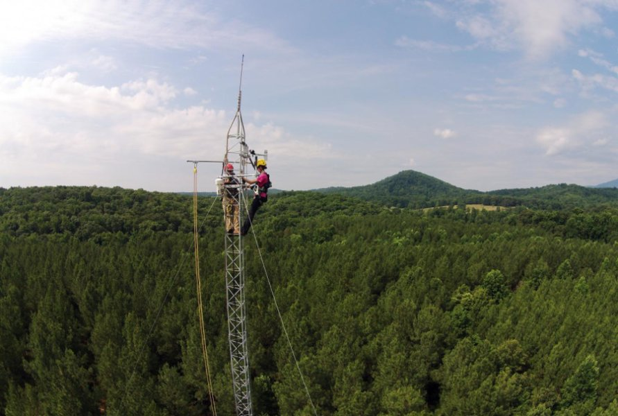 Working atop a 120-foot tower (Credit: Rob Alexander)