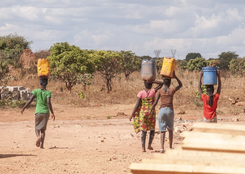 The daily trip to the local well for water - near Kitwe, Zambia