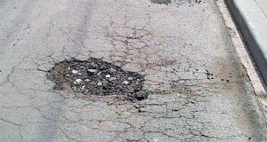 A small pothole ready to be repaired using your gas-tax dollars, and taxes on electric vehicles?