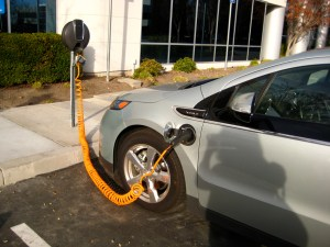 Electric vehicle charging stations attract customers.
