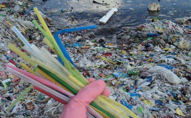 Plastic straws and plastic debris beach pollution