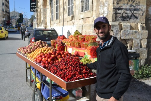 Fruit vendor, Ein Sara Street, Hebron (David Kattenburg)