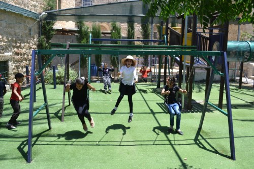 Kids play in Friendship Garden, Hebron old city (David Kattenburg)