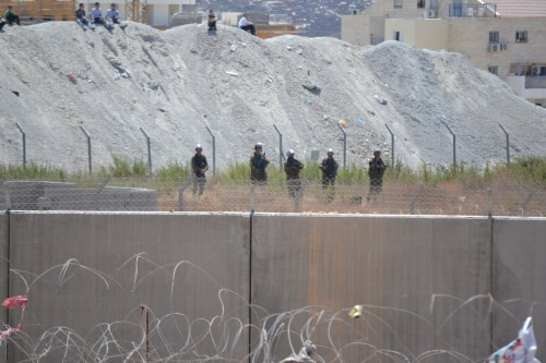 Israeli border police protecting Halamish settlement from Palestinian protesters in Bi'lin (David Kattenburg)