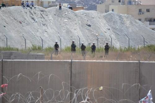 Israeli border police protecting Halamish settlement from Palestinian protesters in Bi'lin (David Kattenburg)
