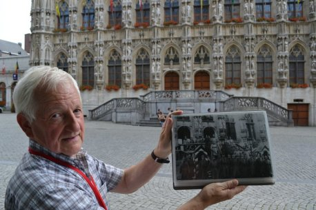 Leuven tour guide Guido Claesen in front of old town hall.