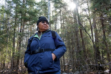 Teresa, standing on the spot where her ancestors once lived (copyright Allan Lissner/Neskantaga)
