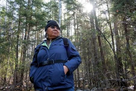 Teresa, standing on the spot where her ancestors once lived (copyright Allan Lissner/Neskantaga)
