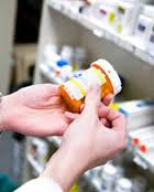 hands holding medicine