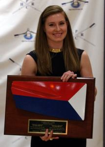 Caroline Lind with her induction award for the Triad Rowers' Hall of Fame.