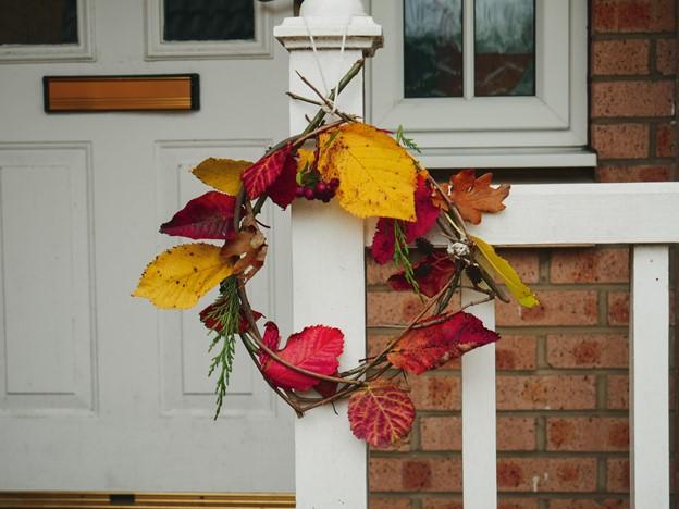autumn leaf wreath hanging outside a house