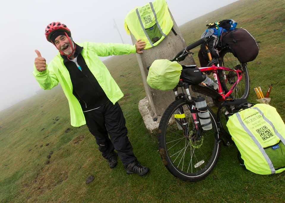Peter Wright with his bike at the end of his watershed cycle