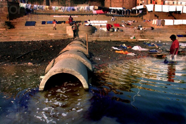 07 Dec 2001, Varanasi, India --- A sewage pipe from one of the Ganges Action Plan boosters overflows pollutants into the Ganges River in Varanasi. Considered the holiest river by Hindus, the Ganges River is now also one of the most polluted. Industrial waste and sewage flows directly into the river which brims with human activity from the millions of devout Hindus who take a holy dip in it everyday. The Ganges Action Plan, launched in 1986 by the government of India, has not achieved any success despite an expenditure of over five billion rupees. --- Image by © Amit Bhargava/Corbis