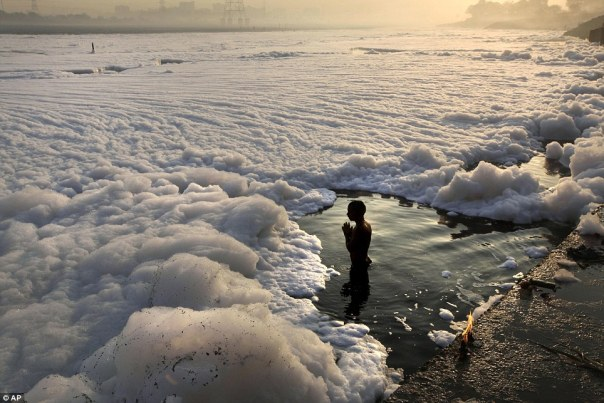 Image Source: http://www.dailymail.co.uk/news/article-2240307/An-industrial-bubble-bath-Hindus-dive-foam-coated-polluted-Yamuna-River-pray-new-moon-ritual.html