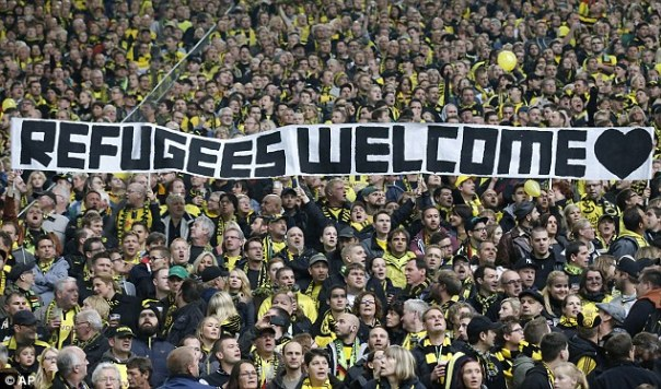 2BEFF0B400000578-3221016-Borussia_Dortmund_supporters_pictured_in_2014_hold_a_banner_duri-a-16_1442068672685
