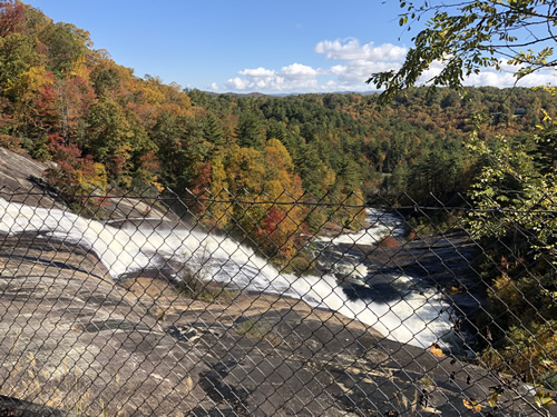 They put up a fence to keep people from climbing the rocks around Toxaway Falls