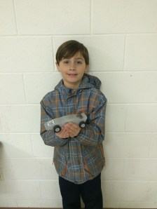 Crew with his Pinewood Derby car.