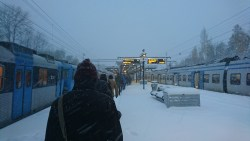 People walking in a single file due to the snow at Helenelund Station