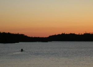 Wilderness rangers paddle down Ensign Lake in the BWCAW