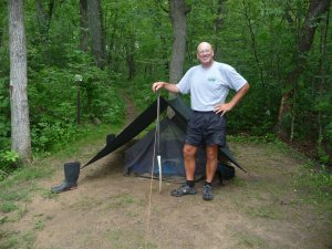 Bill Nedderman and his tarp shelter.