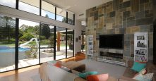 gremmo homes sagars road dural living room and view of outside with glass windows floor to ceiling