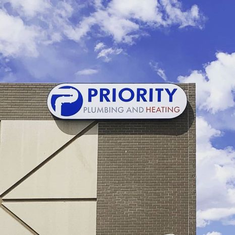 Priority Plumbing and Heating lighted cabinet sign